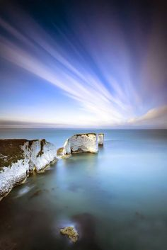 The Old Harry Rocks are three chalk formations, including a stack and a stump, located at Handfast Point, on the Isle of Purbeck in Dorset, southern England.
