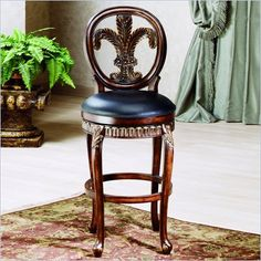 "Hillsdale Fleur De Lis 31"" Swivel Bar Stool in Island Vanity - Classic, elegant and majestic, the Fleur de Lis Swivel Bar Stool is all of this and more. It has a rich warm wood finish with golden highlights and a black leather seat. The back rest's Fleur de Lis symbol, and the stools traditional style, will add elegance to any room in your home."