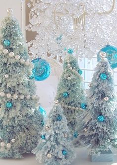 snow covered aqua blue bottle brush christmas tree pearl garland - Blue And Silver Christmas