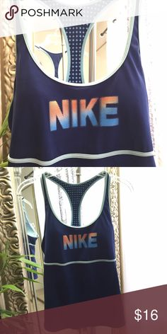 Nike tank Women's.. Like new. In excellent condition. Built in with Padded bra Nike Tops Tank Tops