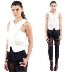 Wrap-Front Top Unsure of what to wear ? Then you're looking at the right top. This Wrap-Front Crop Top featuring pearl detail on it's side pockets, sleeveless cuts to bare arms, back invisible zipper closure and criss-cross wrap front for a more geometric touch. Acting as such a versatile choice that can be ideally worn in any occasion, so if your interested in finding the perfect fit to better flatter your body type this is a key investment. Tops Crop Tops