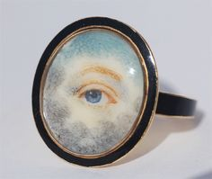 """Georgian eye miniature mourning ring, circa 1800. Blue eye miniature on ivory, painted in the clouds with black enameling on the surround and shank. See """"Georgian Jewellery"""" by Ginny Reddington Dawes, page 164. ©2007 Cathy Gordon."""