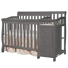 Dream On Me Jayden mini Convertible crib with Changer is a beautifully constructed multipurpose crib which offers a sturdy rails for safety, mattress support, 1 in. The changing table is equipped with a changing pad and r Crib And Changing Table Combo, Best Changing Table, Changing Pad, Small Crib, 4 In 1 Crib, Cribs For Small Spaces, Best Baby Cribs, Best Crib, Crib Mattress