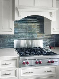 Artistic Tile I Gotham Steel tile looks outstanding in the backsplash of this Syosset, NY home! The Michael Aram for Artistic Tile collection infuses homeware and jewelry designer Michael Aram's signature style into high quality ceramic tile. I Interior Designer: Nicky Kahn Design Associate: and to our Manhasset, NY showroom rep Susan Pauleen