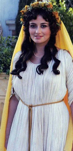 This image represents how a Roman women would wear an  orange veil, called a flammeum with orange blossoms on her wedding day. This is still being done in the modern day world.