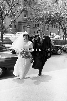 An unusual sight at UCD ( Earlsfort Terrace) as groom John Quirke, Straffan, Co Kildare, arrives with his bride of 45 minutes, Mary Claire Harney, Stapleton Place, Dundalk, to receive his B.E. on Conferring Day. 14.07.1964. Photo Archive, Dublin, Claire, Terrace, Groom, Mary, Lost, Events, Bride