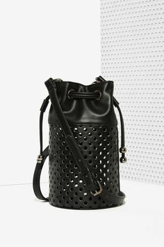 The Nasty Gal x Nila Anthony Tila Perforated Bucket Bag is perf ; )
