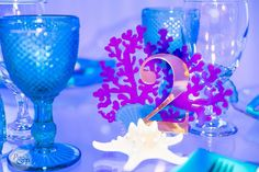 Table numbers that perfectly matched our theme by Glassware Photo by Planned & Designed… Plan Design, Table Numbers, Wine Glass, Party Ideas, Photo And Video, How To Plan, Tableware, Blue, Wedding Table Numbers