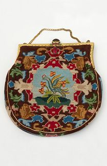 Needlepoint bag with petit point birds, c.1920. What joy and gaiety in the brilliant design with two mythological birds—different on front and back! The design was worked in fine wool petit point. The bag is hung from a gold tone metal frame and is lined with aqua silk. Inside are two pockets with a matching change purse and silk backed mirror. The bag closes with a jeweled cloisonné clasp and has a linked chain handle. Vintage Textile.