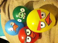Angry Bird balloons faces made with construction paper and taped onto the balloon