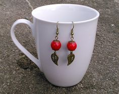 red glass bead and bronze leaf charm earrings