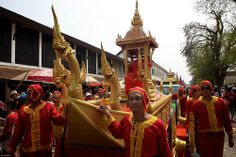 laos-luang-prabang-laos-new-year-phi-mai-lao-men-in-red-and-yellow-lead-monks-tiger trail-cyril-eberle CEB-5449.jpg