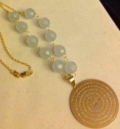 He encontrado este interesante anuncio de Etsy en https://www.etsy.com/es/listing/219076262/amethyst-beads-and-gold-filled-padre