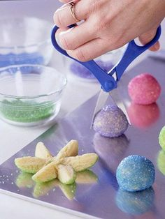 Easter flower cookies...looks pretty easy! Roll a sugar cookie dough ball in colored sugar. Snip it in half with scissors, then snip each half into three petals. Gently spread the petals apart and lay flat.