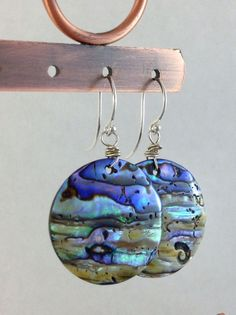 Round abalone shell earrings. Sterling silver jewelry. Natural Paua shells on silver French hooks. Seashell earrings. Handmade jewelry from Gems by Kelley on Etsy. #etsy #gemsbykelley