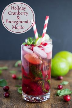 Holiday Cranberry Pomegranate Mojito made with fresh mint, cranberry reduction, pomegranate juice and fresh lime.