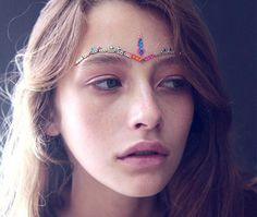 Obsessed with these stick on face beads