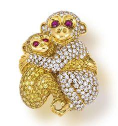 A colored diamond and diamond monkey brooch