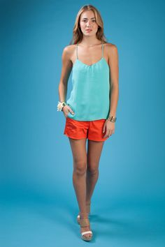 Ellie tank in ice blue with a vermillion Lindy short.