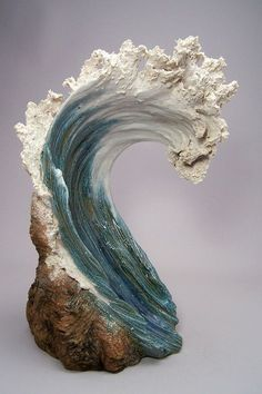 Denise Romecki finds inspiration for her sculptures in cresting waves. Romecki creates her original pieces using stoneware clay. Requiring at least two kiln firings her ceramic sculptures resemble beautifully rising white-capped waves that have been stunningly frozen in time. (Source)