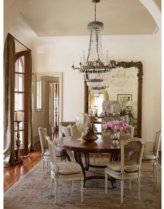 Antique Gilt Floor Mirror, Crystal And Metal Chandelier, French Cane Back  Cushioned Chairs Dining