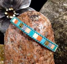 A personal favorite from my Etsy shop https://www.etsy.com/listing/274156750/teal-leather-tila-bead-bracelet