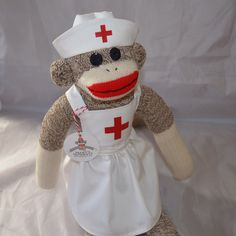 Sock Monkey Doll Nurse  ~ Dressed in her nurse uniform and cap made of cotton. ~ She is made from a large Rockford red heel sock. Each sock monkey