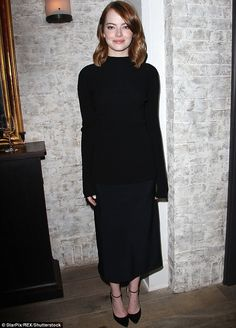 Dark horse: Emma Stone stole the show at a La La Land luncheon in New York on Sunday...