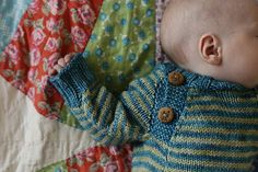 This picture is so heartwarming! And look at those WoolyMossRoots buttons (chickens in Oregon myrtlewood) on my friend Nicole's handknit for her baby boy. Love!