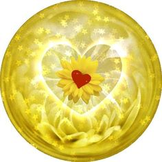 A YELLOW PAPERWEIGHT WITH A YEELOW FLOWER IN THE CENTER AND A LITTLE RED HEART IN THE MIDDLE OF THAT.