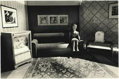 """Laurie Simmons """"a woman listening to the radio"""" Using dolls, dollhouses, dummies, and figures cut from magazines, Laurie Simmons constructs and photographs voyeuristic scenes of dreamlike distortions that challenge sensory perceptions."""