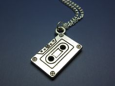 Cassette tape Necklace - mix tape retro jewelry 80s 90s geek jewellery geeky nerdy rockabilly emo punk kitschy silver plated szeya designs. $12.00, via Etsy.