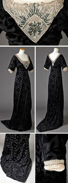 Evening dress, ca. 1905-15. Black silk voided velvet with large floral and leaf motifs. Low square neckline in front; low V-neckline in back. Neckline outlined with ecru net solidly covered with silver, black, and white beads and rhinestones. Narrow, almost hobble skirt, train. Goldstein Museum, Univ. of Minnesota