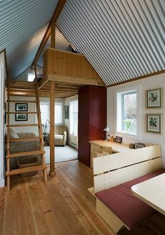 I love the open design to this tiny home. Definitely a rectangular design! Aw, to hear the rain on that tin roof.