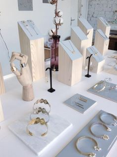Display works up in levels, with the lowest displays at the front. Angled displays designed to present pieces to the viewer.    Find wooden hands at Mannequin Madness