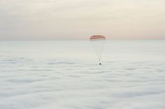 One-Year Crew Returns to Earth The Soyuz spacecraft is seen as it lands with Expedition 46 Commander Scott Kelly of NASA and Russian cosmonauts Mikhail Kornienko and Sergey Volkov of Roscosmos. Nasa Photos, Nasa Images, Photos Du, Scott Kelly, Soyuz Spacecraft, Refugee Crisis, Nasa Astronauts, Space Race, International Space Station