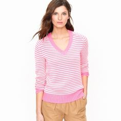 J.Crew Pink Stripe Sweater Oh-so-comfy cotton v-neck sweater in pink neon stripe from J.Crew. This cute cold weather staple is in perfect condition. It has no defects of any kind (stains, rips, tears, etc.) It is a size XXS and fits true to size. J. Crew Sweaters V-Necks