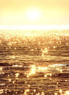 Alluring sunlight reflects upon the glassy #ocean waves casting dazzling flashes of lights resembling sparkling #diamonds in the sea.