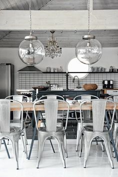 Industrial pieces and Black & White prints in a Swedish white home