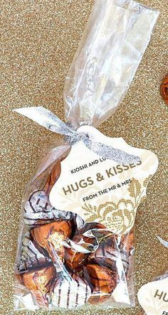 Three Budget-Friendly Wedding Favor Ideas Little paper bags with our initials and wedding date on it at the candy buffet. Hugs and Kisses Wedding Favors Wedding Favors And Gifts, Summer Wedding Favors, Wedding Reception Favors, Wedding Invitations, Personalized Wedding Favors, Cheap Bridal Shower Favors, Wedding Favours Unique, Wedding Guest Gifts, Wedding Reception Decorations On A Budget