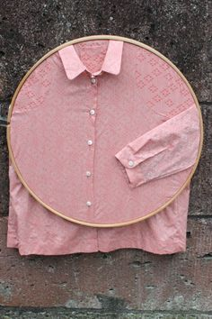 hoop - plain coloured clothes inside and work pinned onto the fabric and on the wall