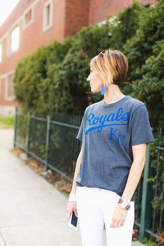 How to look chic at a baseball game. Royals baseball t-shirt, white denim, ombre bob, leather earrings.