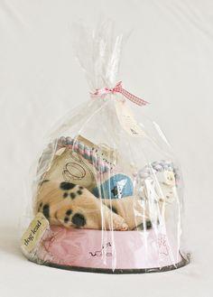 New puppy gift basket include: baby blanket, bowls, collar, treats, bones, tennis ball, carpet cleaner etc...