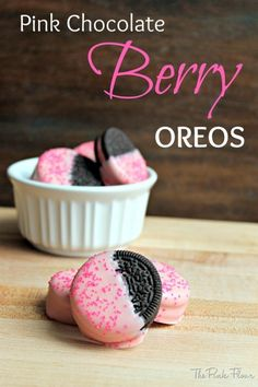 Pink Chocolate Berry Oreos  1 package Berry Ice Cream Oreos  2 12oz. bags of pink chocolate candy melts  Pink Sprinkles, Optional Pour pink chocolate into microwave-safe container. Heat in microwave for 20 seconds and then stir. Continue heating at 10 second intervals; stirring in between until chocolate is melted. Cover cookie sheet with wax paper. Dip cookies halfway into melted chocolate and then place on wax paper