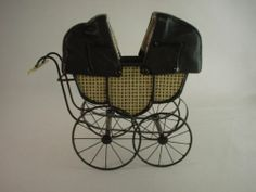 Buggies - English Pram for Twin Babies $600.00 English pram for twin babies, Handcrafted by English miniature artisan. Very unique piece, copied from a rare Victorian original, it has double hoods, which open and close with working metal hinges. Hoods are covered in soft black kidskin, and lined in silk. Pram itself is lined with tufted kidskin. Tufts are so tiny and so many worked closely together that they are impossible to photograph.