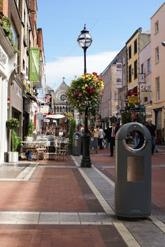 http://www.hartecast.co.uk/street-furniture/ A good example of the right blend of traditional and contemporary design seen in this beautiful image of a busy town promenade. Visit our site for more modern litter bin designs.