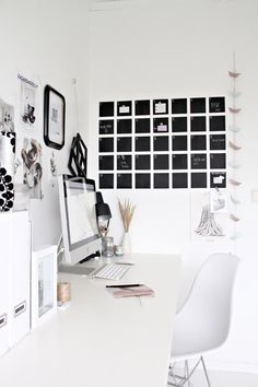Desk organization with a pinning board along the wall. clean, organized desk space.