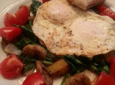 Country style hash with chicken sausage, local potatoes & baby power greens served with Davidson's Safest Choice over easy eggs and greenhouse tomatoes.