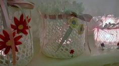 Three upcycled candle jars dressed in cotton doileys and decorated with flowers cut from a dress my daughter wore as a little girl - beautiful now for her bedroom