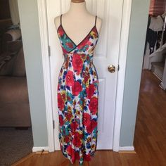 """Red floral spaghetti v neck cinched a line Comes from a smoke free pet friendly home. Fits small to medium. 51"""" long 41"""" from back stretchy bar Dresses"""